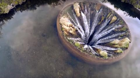 The Unbelievable Hole Found In The Middle Of A Portuguese Lake