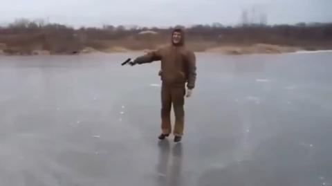 Watch What Happens When This Man Fires A Gun At A Frozen Lake