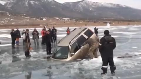 Ever Wondered How You Would Get A Car Out Of A Frozen Lake? Watch These Guys Do It Without A Tow Truck