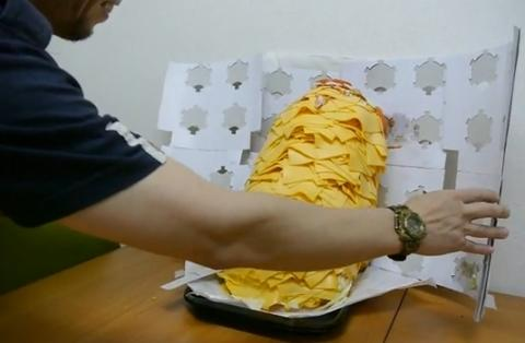 This man ordered a burger with 1000 cheese slices - the way he eats it is really something