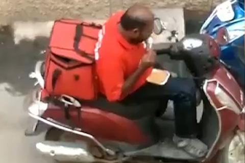 Cheeky Delivery Driver Caught Red Handed As He Eats Customer's Food Before Resealing The Box