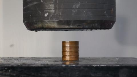 The Fascinating Outcome Of A Hydraulic Press Crushing A Pile Of Coins