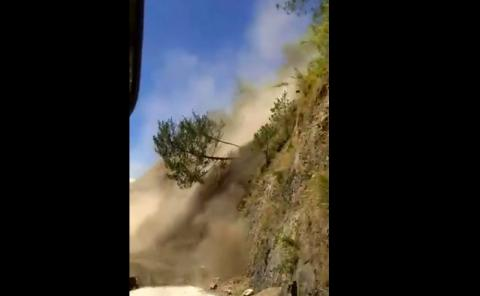 Terrifying Footage Of A Bus Getting Stuck In A Landslide