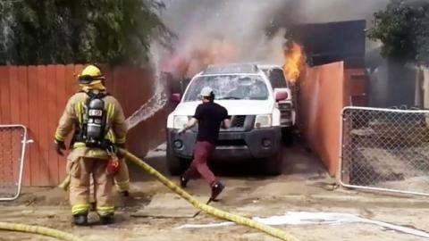 Watch As This Man Risks His Life By Going Into A Burning House On Fire To Save His Dog