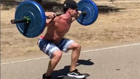 This Unbelievable Fitness Influencer Does Squats Whilst On A Longboard