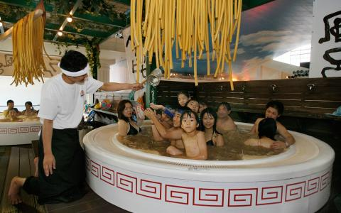 Inside this Japanese spa you can relax in a bath full of noodles!