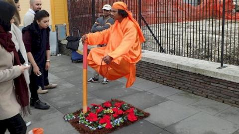 Ever Wonder How Street Performers Are Able To Make It Look Like They're Levitating?