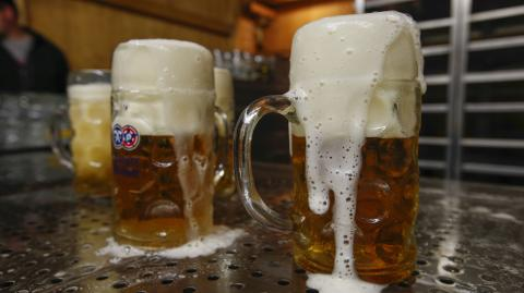 Why do bartenders wet the glass before serving the beer?