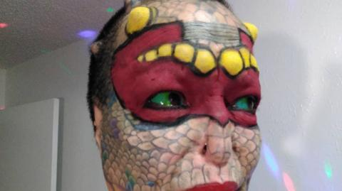Former banker spends $75,000 to become a reptile