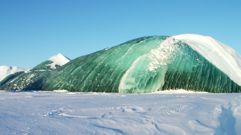 A scientist has finally unravelled the mystery of these 'alien' green' icebergs