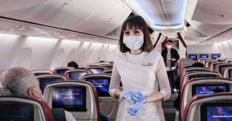 Tensions turn to panic after a woman was tackled by Thai Airways crew after she deliberately coughs on a stewardess