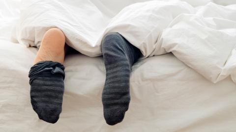 Doctor explains why we should actually be wearing socks to bed