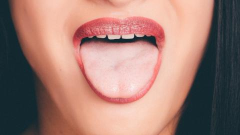 Here's why your tongue is white and how you can get rid of it