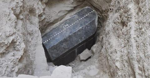 A mysterious black sarcophagus baffling archaeologists has been opened