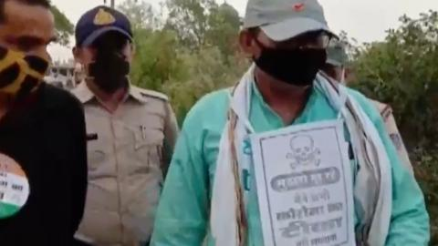 Indian police stick 'stay away from me' posters on unvaccinated citizens