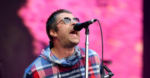 Watch The Beautiful Moment Liam Gallagher Fans Lift Man In Wheelchair To Best View In House