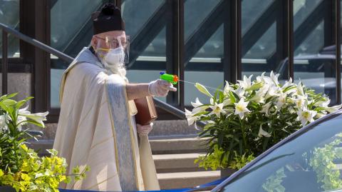 In Detroit, a Priest Is Battling Coronavirus With a Squirt Gun