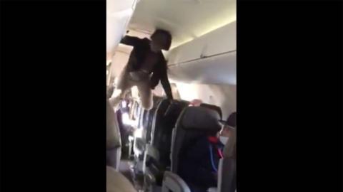 'Demoniac Woman' Has a Complete Melt Down On Flight (VIDEO)