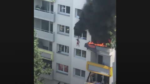 Two Children Leaped From a Burning Building to Escape Certain Death