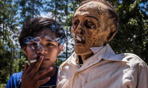 This Indonesian tribe digs up their dead every year to give them a makeover