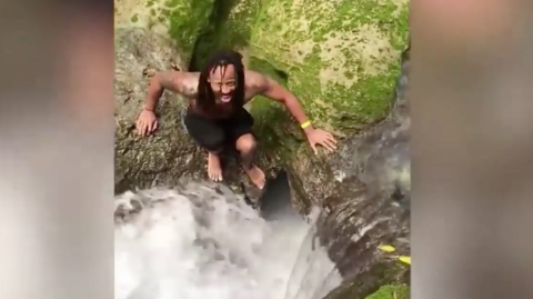 Watch as these two tourists jump into a waterfall and disappear into the jungle