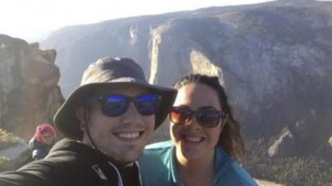 This selfie actually turned out to contain an incredibly tragic photobomb