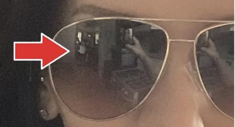 She saw something terrifying in the reflection in her sunglasses while taking a selfie