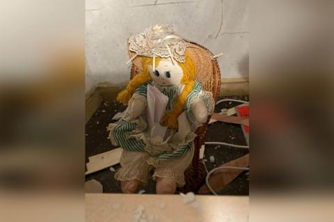 Man finds creepy doll and eerie note inside wall of new home